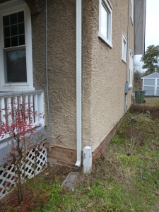 If a downspout is connected, you may be able to re-direct the outflow so that it soaks into the ground rather than reaching the street.